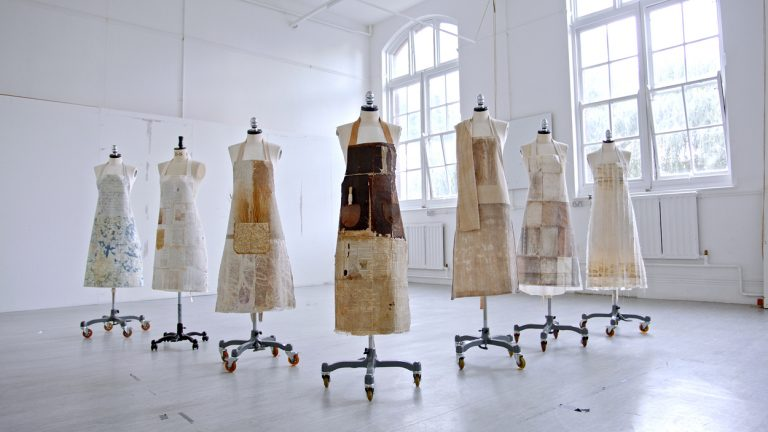 MA Textile Design work by Caroline Hyde-Brown depicting a collection of Agri-Textile Paper cloth aprons.