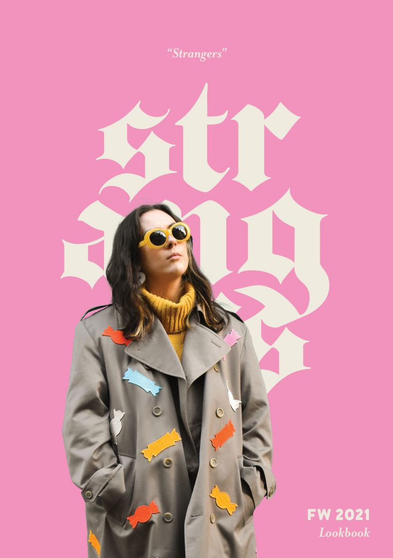 """MA Communication Design work by Marla DiPoto showing a fashion lookbook cover entitled """"Strangers"""". Image shows model in a beige coat with colourful images on and yellow sunglasses against a pink background with the word 'Strangers' in white."""